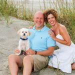 God's Driection for my life changed starting with this little puppy, Sammy. Picture of the family and Sammy on the beach